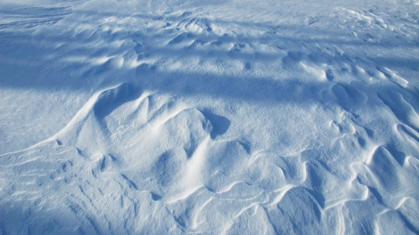 wind-shaped snow formations resemble a sandy beach