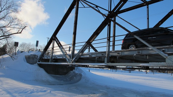 the bridge on the return trip; the river snow and ice is so high you have to duck your head as you walk underneath!